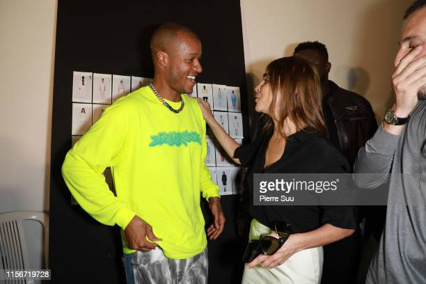 Carine Roitfeld and Heron Preston pose backstage after the Heron Preston Menswear Spring Summer 2020 show as part of Paris Fashion Week on June 18,...