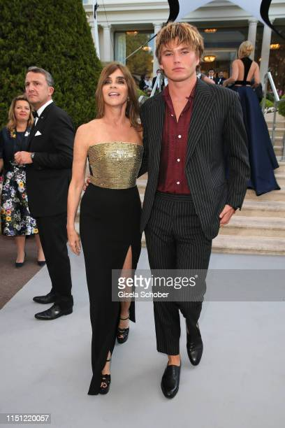 Carine Roitfeld and Jordan Barrett attend the amfAR Cannes Gala 2019 at Hotel du Cap-Eden-Roc on May 23, 2019 in Cap d'Antibes, France.