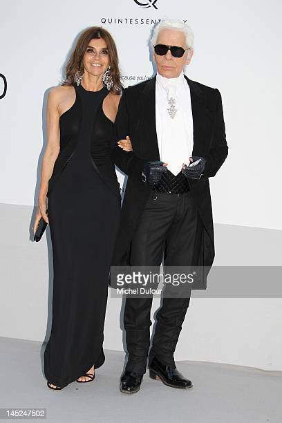 Carine Roitfeld and Karl Lagerfeld attend the 2012 amfAR's Cinema Against AIDS during the 65th Annual Cannes Film Festiva at Hotel Du Cap on May 24...