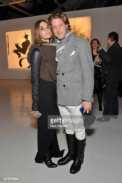 Carine Roitfeld and Lapo Elkann attend the private view of 'The Godfather Of Street Art' sponsered by Armani at The Dairy on November 18 2010 in...