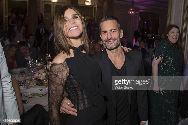 Carine Roitfeld and Marc Jacobs attend the amfAR dinner at the Pavillon LeDoyen during the Paris Fashion Week Haute Couture on July 5 2015 in Paris...