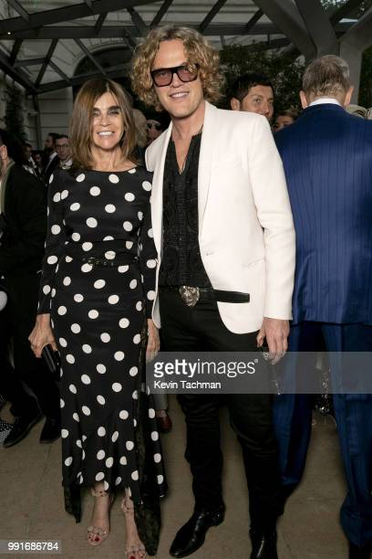 Carine Roitfeld and Peter Dundas attend the amfAR Paris Dinner at The Peninsula Hotel on July 4 2018 in Paris France