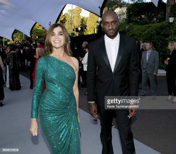 Carine Roitfeld and Virgil Abloh arrive at the amfAR Gala Cannes 2018 at Hotel du CapEdenRoc on May 17 2018 in Cap d'Antibes France