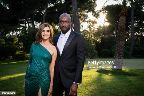 Carine Roitfeld and Virgil Abloh pose for portraits at the amfAR Gala Cannes 2018 cocktail at Hotel du CapEdenRoc on May 17 2018 in Cap d'Antibes...