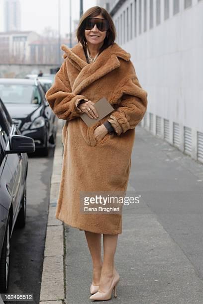 Carine Roitfeld attends the Milan Fashion Week Womenswear Fall/Winter 2013/14 on February 23 2013 in Milan Italy