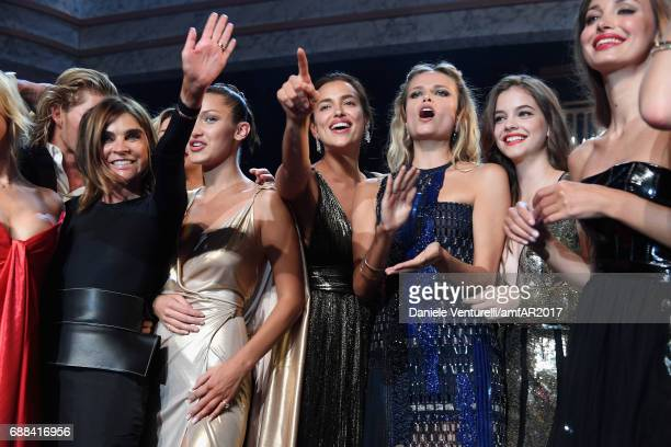 Carine Roitfeld Bella Hadid Irina Shayk Natasha Poly Barbara Palvin and Lara Lieto are seen on stage at the amfAR Gala Cannes 2017 at Hotel du...