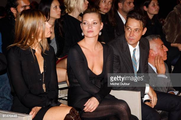 Carine Roitfeld Kate Moss and Jamie Hince attend Yves Saint Laurent Pret a Porter show as part of the Paris Womenswear Fashion Week Spring/Summer...