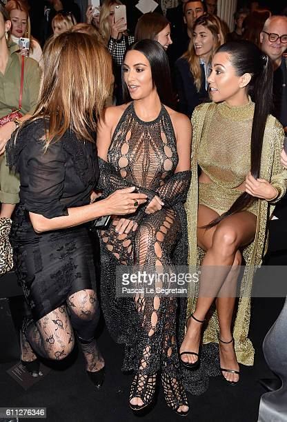 Carine Roitfeld Kim Kardashian and Kourtney Kardashian attend the Balmain show as part of the Paris Fashion Week Womenswear Spring/Summer 2017 on...