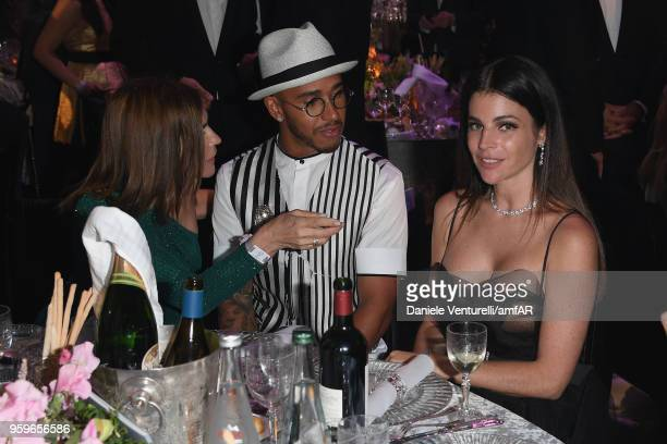 Carine Roitfeld Lewis Hamilton and Julia RestoinRoitfeld attend the amfAR Gala Cannes 2018 dinner at Hotel du CapEdenRoc on May 17 2018 in Cap...