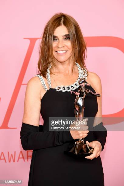 Carine Roitfeld poses the Founder's Award in Honor of Eleanor Lambert during the Winners Walk during the CFDA Fashion Awards at the Brooklyn Museum...