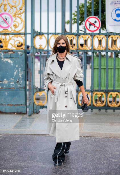 Carine Roitfeld seen wearing trench coat outside Dior during Paris Fashion Week - Womenswear Spring Summer 2021 : Day Two on September 29, 2020 in...