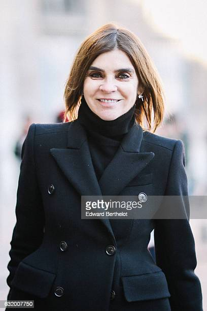 Carine Roitfeld Vogue Paris Editor in Chief is wearing a black long coat black pants and red heels after the Balenciaga show during Paris Fashion...