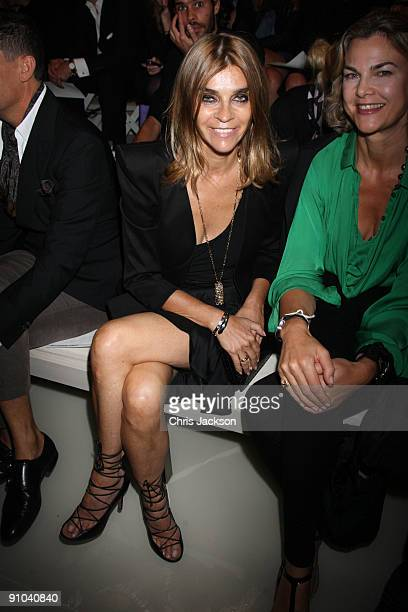 Carine Roitfeld watches the Burberry Prorsum Spring/Summer 2010 Show at Rootstein Hopkins Parade Ground during London Fashion Week on September 22...