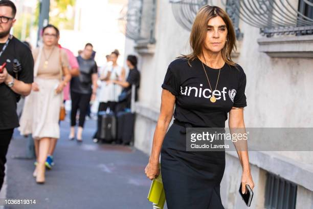 Carine Roitfeld wearing a Unicef black t shirt and skirt is seen in the streets of Milano before the Prada show during Milan Fashion Week...