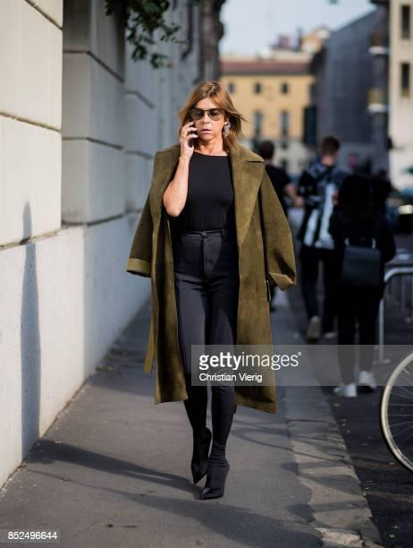 Carine Roitfeld wearing olive coat navy pants is seen outside Bottega Veneta during Milan Fashion Week Spring/Summer 2018 on September 23 2017 in...