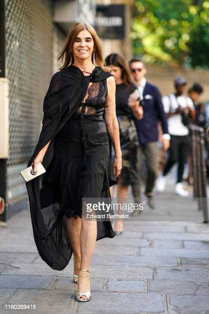 Carine Roitfeld wears a black mesh lace dress, silver shoes, outside Valentino, during Paris Fashion Week -Haute Couture Fall/Winter 2019/2020, on...