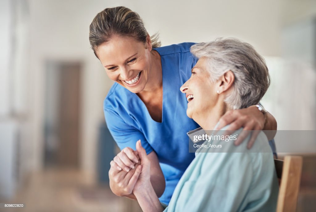Caring comes naturally to her : Stock Photo