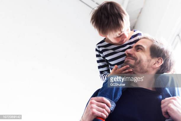 caring father and loving son spending quality time at home - prop stock photos and pictures
