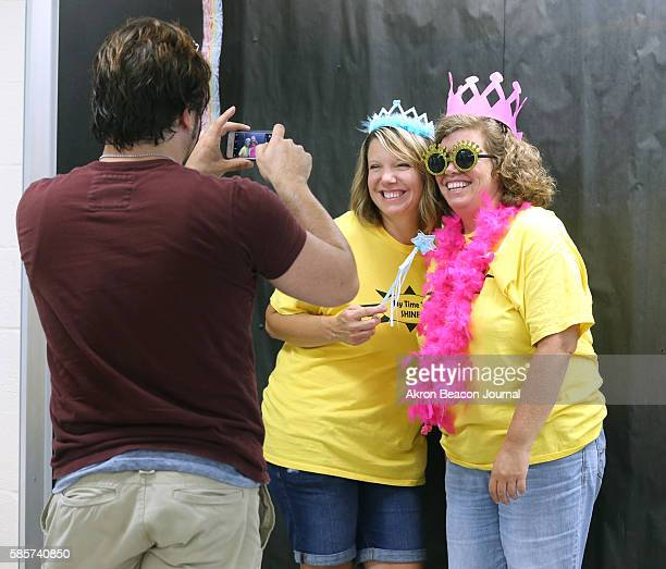 Caring for Kids workers Stephanie Novak left and Lydia Keto pose for a photo on Monday Aug 1 in Cuyahoga Falls Ohio at Roberts Middle School