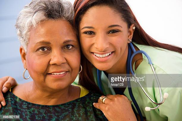 Caring, mixed-race nurse and senior patient in hospital.