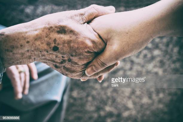 caring - gripping stock pictures, royalty-free photos & images