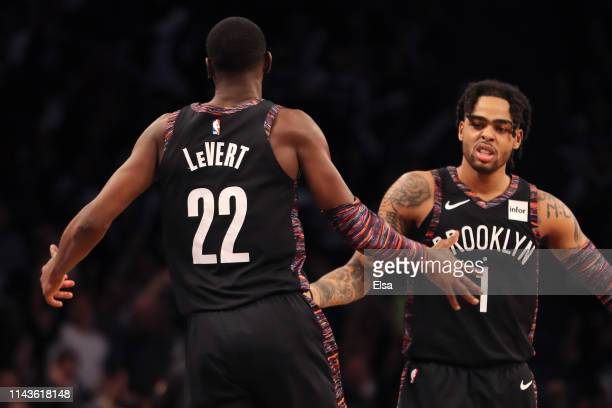 Caris LeVert and D'Angelo Russell of the Brooklyn Nets react after a basket in the second quarter against the Philadelphia 76ers during game three of...
