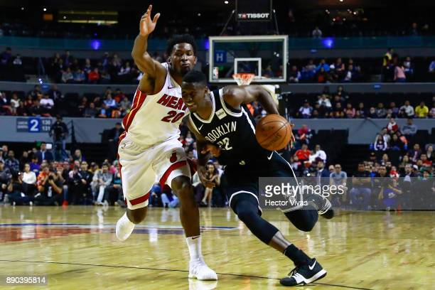 Caris Levert of Brooklyn Nets handles the ball against Justice Winslow of Miami Heat during the NBA game between the Brooklyn Nets and Miami Heat at...
