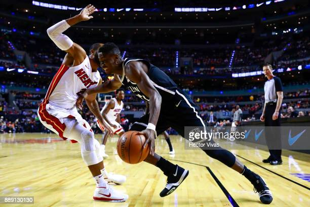 Caris Levert of Brooklyn Nets handles the ball against Wayne Ellington of Miami Heatduring the NBA game between the Brooklyn Nets and Miami Heat at...
