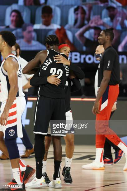 Caris LeVert of the Brooklyn Nets and Shabazz Napier of the Washington Wizards embrace following the game on August 2, 2020 at The Arena at ESPN Wide...