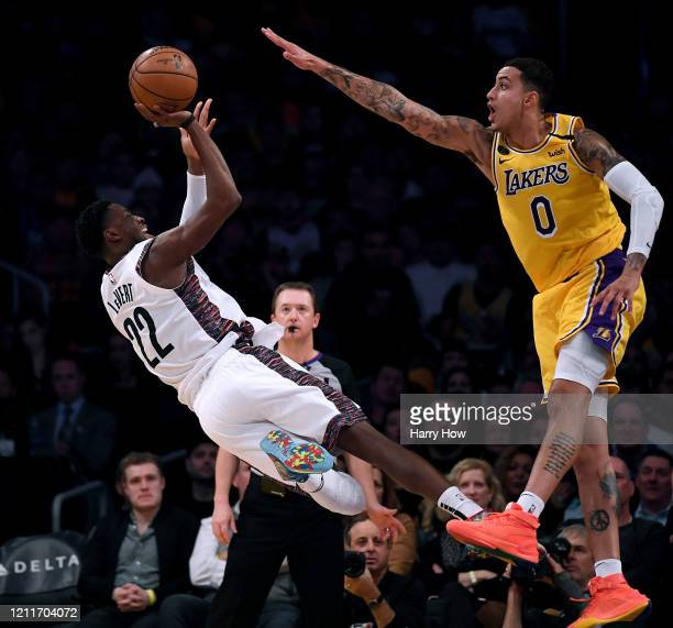 Caris LeVert of the Brooklyn Nets attempts a shot in front of Kyle Kuzma of the Los Angeles Lakers during a 104-102 Nets win at Staples Center on...