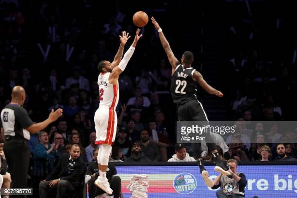 Caris LeVert of the Brooklyn Nets blocks a shot by Wayne Ellington of the Miami Heat in the second quarter during their game at Barclays Center on...