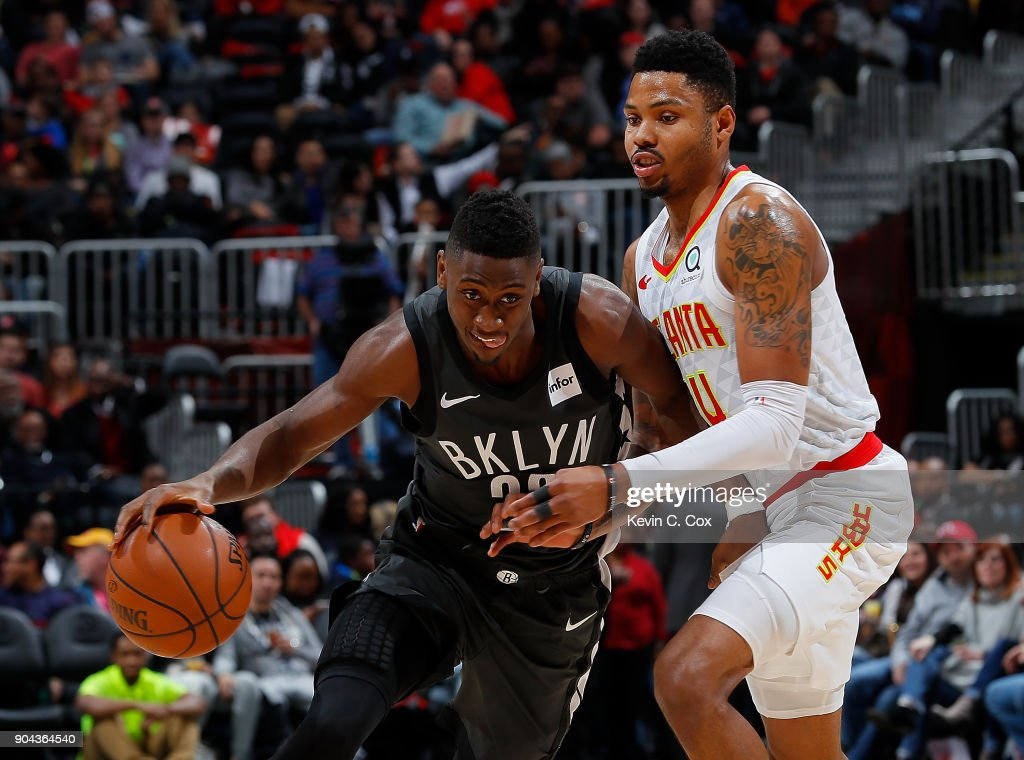 Caris LeVert #22 of the Brooklyn Nets drives against Kent Bazemore #24 of the Atlanta Hawks at Philips Arena on January 12, 2018 in Atlanta, Georgia.