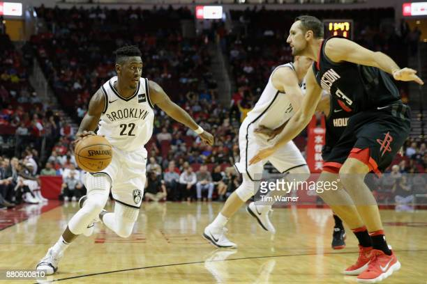 Caris LeVert of the Brooklyn Nets drives to the basket defended by Ryan Anderson of the Houston Rockets in the first half at Toyota Center on...