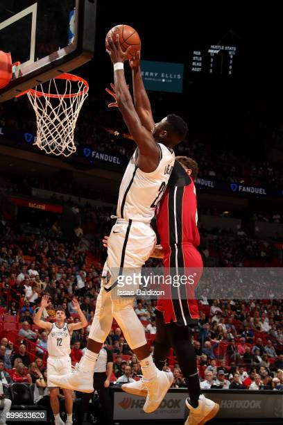 Caris LeVert of the Brooklyn Nets dunks the ball during the game against the Miami Heat at the American Airlines Arena on December 29 2017 in Miami...