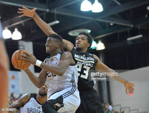 Caris LeVert of the Brooklyn Nets goes in for a layup against Sterling Brown of the Milwaukee Bucks during the 2017 Summer League game at the Cox...
