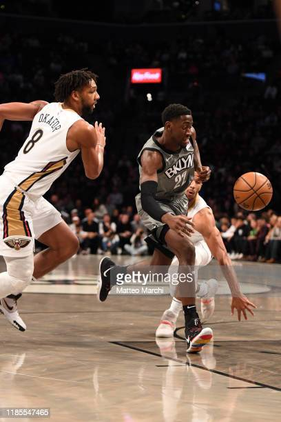 Caris LeVert of the Brooklyn Nets handles the ball against Jahlil Okafor of the New Orleans Pelicans during the game at Barclays Center on November...