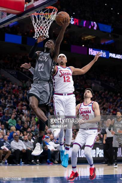 Caris LeVert of the Brooklyn Nets shoots the ball against Tobias Harris of the Philadelphia 76ers in the second quarter at the Wells Fargo Center on...