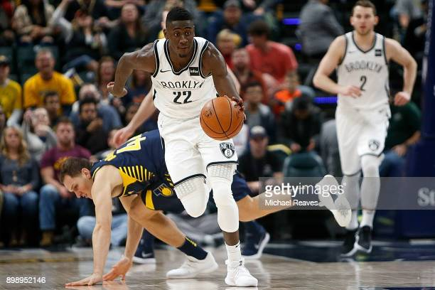 Caris LeVert of the Brooklyn Nets steals the ball from Bojan Bogdanovic of the Indiana Pacers during the second half at Bankers Life Fieldhouse on...