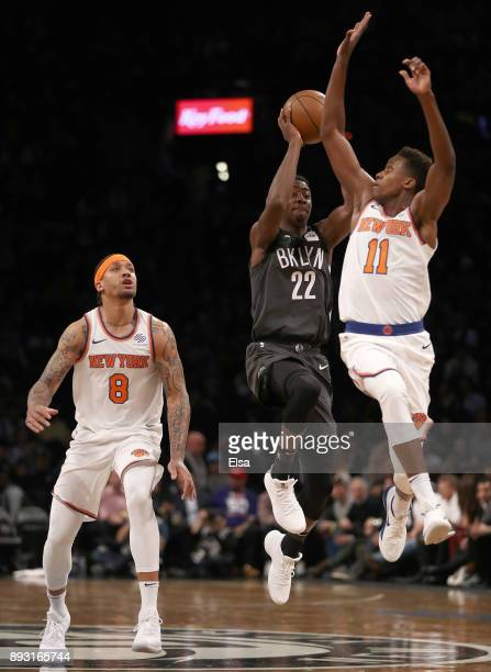 Caris LeVert of the Brooklyn Nets takes a shot at the buzzer as Michael Beasley and Frank Ntilikina of the New York Knicks defend at the Barclays...