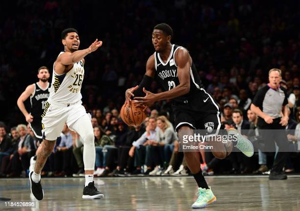 Caris LeVert of the Brooklyn Nets takes control of the ball as Jeremy Lamb of the Indiana Pacers guards him during the first half of their game at...