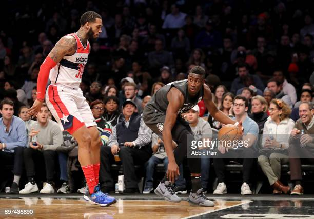 Caris LeVert of the Brooklyn Nets works against Mike Scott of the Washington Wizards in the second half during their game at Barclays Center on...
