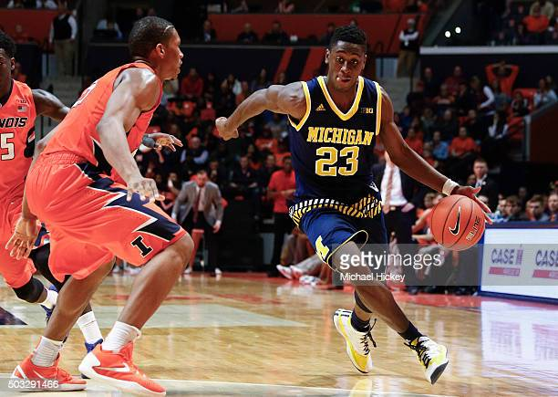 Caris LeVert of the Michigan Wolverines brings the ball up court during the game against the Illinois Fighting Illini at State Farm Center on...