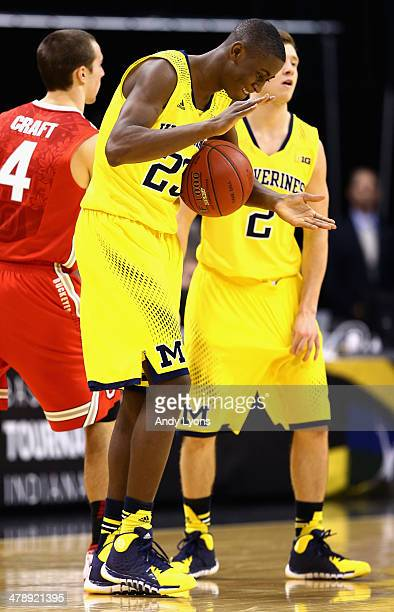 Caris LeVert of the Michigan Wolverines celebrates after getting the rebound in the last few seconds of the Big Ten Basketball Tournament Semifinal...