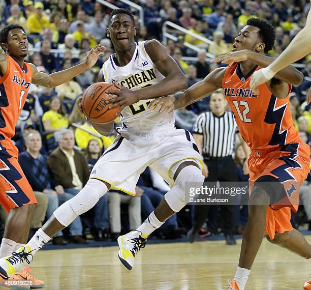 Caris LeVert of the Michigan Wolverines goes to the basket against Leron Black of the Illinois Fighting Illini during the first half at Crisler Arena...
