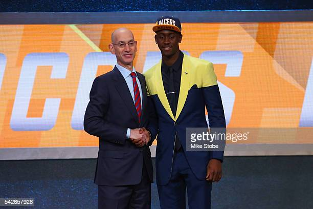 Caris Levert shakes hands with Commissioner Adam Silver after being drafted 20th overall by the Indiana Pacers in the first round of the 2016 NBA...