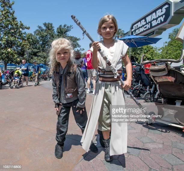 Carissa Rindfleisch dressed as Jyn Erso and her sister Carleigh Rindfleisch dressed as Rey in Tomorrowland at Disneyland in Anaheim California on...