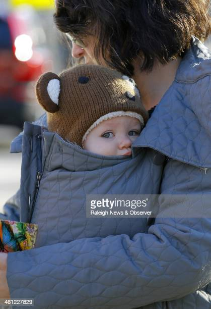 Carissa White bundles her 10monthold daughter Zoe White in her coat papoosestyle as she prepares to take her to daycare in Raleigh NC Tuesday Jan 7...