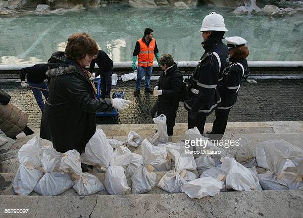 Caritas employee counts bags of coins collected at the Trevi Fountain November 28 2005 in Rome Italy Tourists from all over the world come to Rome's...