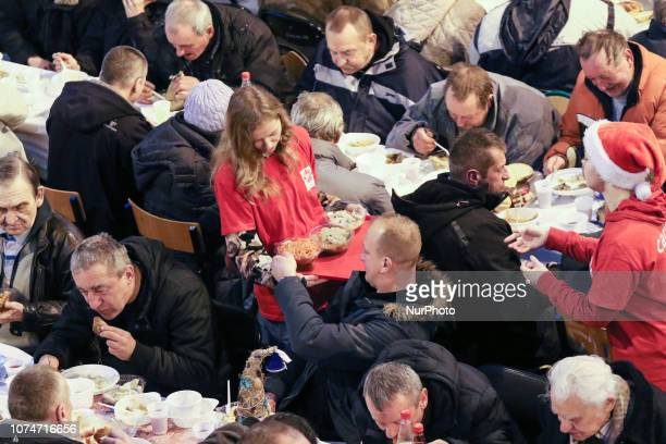 Caritas volunteers are seen Over 300 people took part in the Christmas Eve meal in Sopot Poland on 24 December 2018 Traditional Polish Christmas Eve...