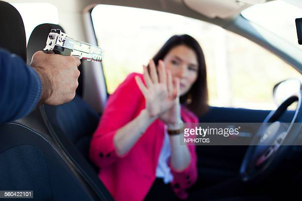 carjacking - armed robbery stock photos and pictures